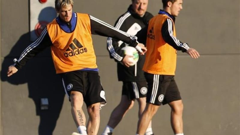 Striker Fernando Torres (L) has already come to life under new Chelsea manager Rafael Benitez (C) [Reuters]