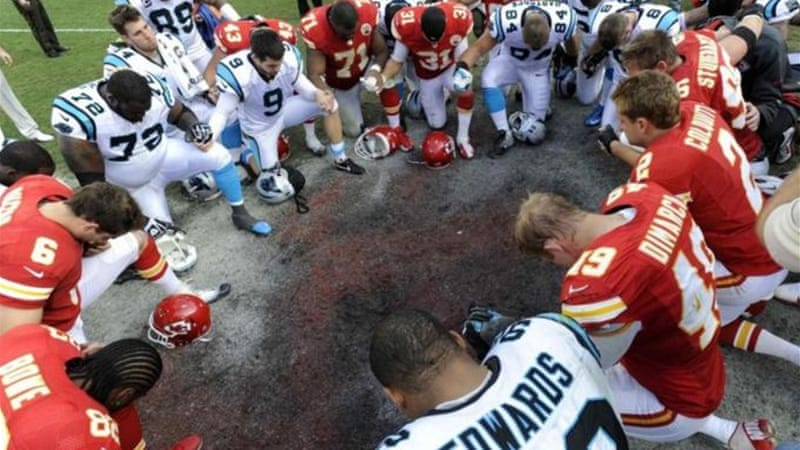 Kansas City Chiefs and Carolina Panthers players form a prayer circle following the Chiefs' win [Reuters]