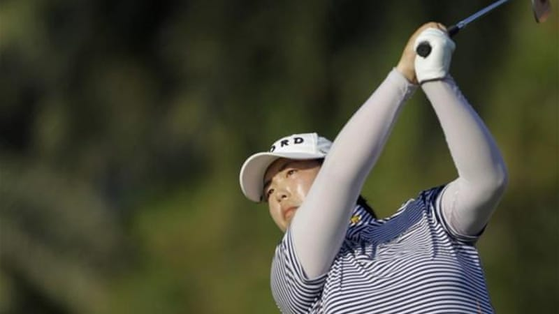 Sixth-ranked Shanshan Feng is confident going into the final round with lead over Dewi Claire Schreefel [AP]