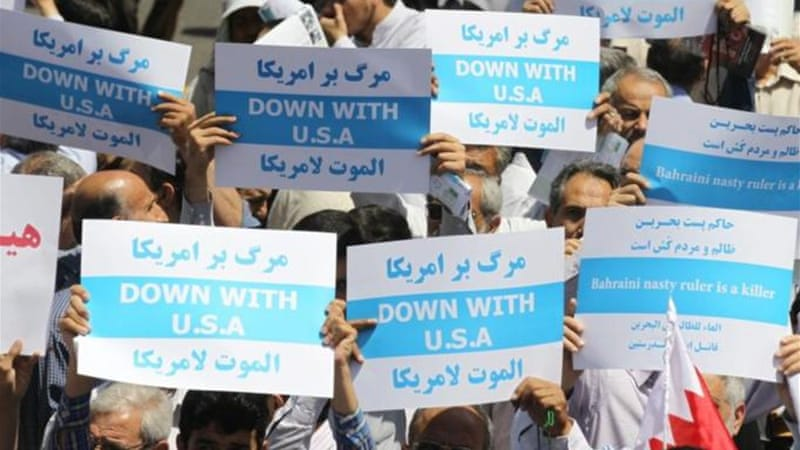 Iranian anti-Saudi demonstrators held up placards during a protest after the Friday noon prayer in Tehran [AFP]