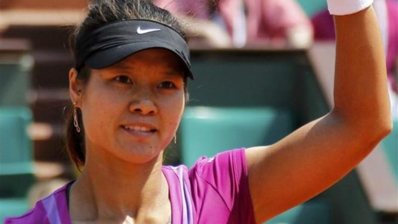 Li Na of China waves to the crowd after winning her match against Romanian Sorana Cirstea [GETTY]