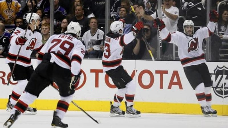 New Jersey Devils' Adam Henrique (R) celebrates scoring game winner against Los Angeles Kings [Reuters]