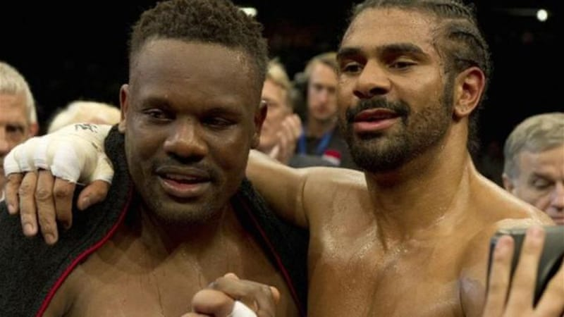 Chisora, left, and Haye pose for the cameras after settling their differences in the ring [AP]