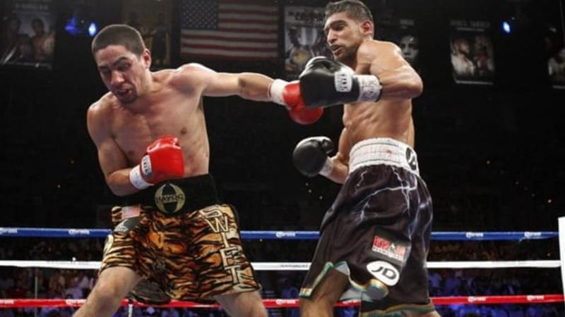 Garcia, left, said that Khan had underestimated his power ahead of their WBA light-welterweight bout [Reuters]