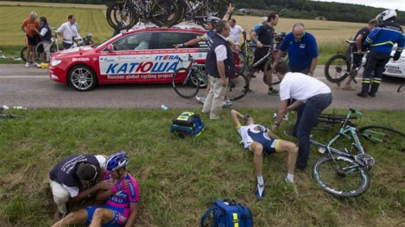 Cyclists receiving medical assistance has been a familiar sight on Tour [AFP]