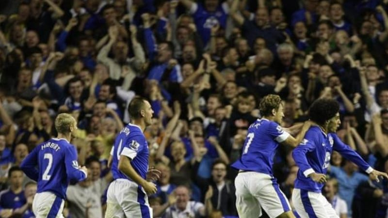 Everton's Marouane Fellaini, right, celebrates a great header after a fantastic individual performance [AP]