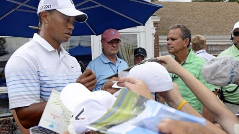 Tiger Woods is growing used to sharing the limelight with young Irishman Rory McIlroy [AP]