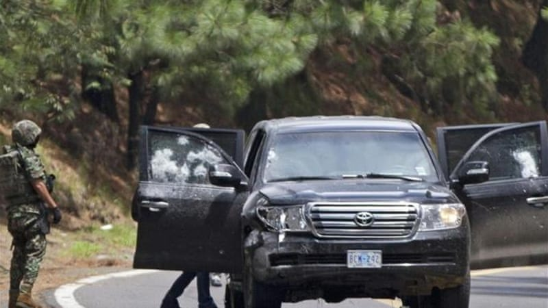 Pictures from the scene showed the Toyota vehicle riddled with bullet-holes [AP]