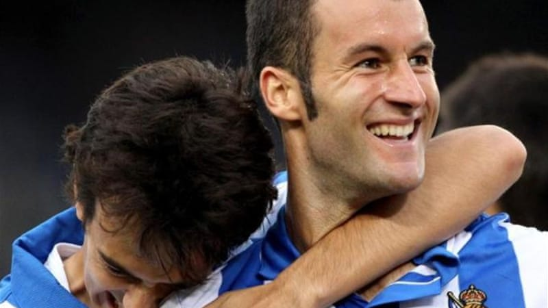 Real Sociedad's forward Imanol Agirretxe (R) celebrates with teammate after scoring winner [EPA]