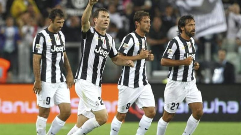 Lichtsteiner (2nd L) opened the scoring for Juventus after a failed spot-kick conversion [GALLO/GETTY]