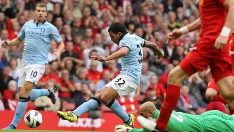 Tevez pounces on a mistake from Liverpool in a game where City were uncharacteristically on the backfoot [EPA]