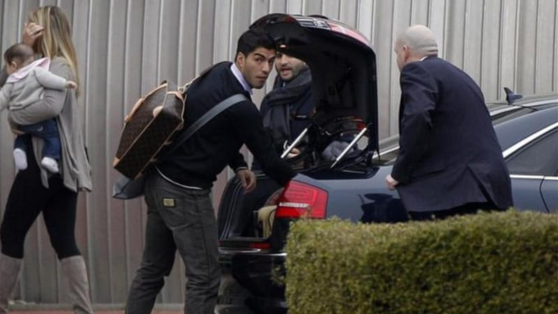 Suarez won't need to pack his bags any time soon after signing new contract with Liverpool [AFP]