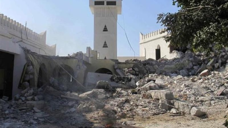 Libyan Salafis used a bulldozer to destroy the Sidi Shaab Sufi mosque in Tripoli [REUTERS]