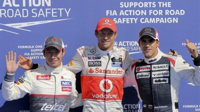 Not a familiar top three! Kobayashi (L) and Maldonado (R) join Button on the podium after qualifying [EPA]