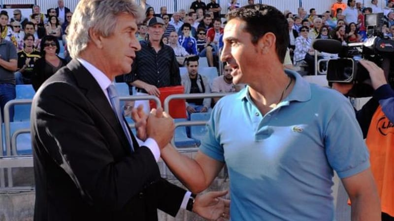 Malaga head coach Manuel Pellegrini (L) has had to leave his signings late due to financial worries [GETTY]