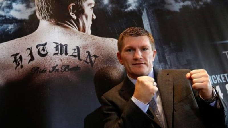 Hatton poses at press conference after confirming he will resume his boxing career [GALLO/GETTY]
