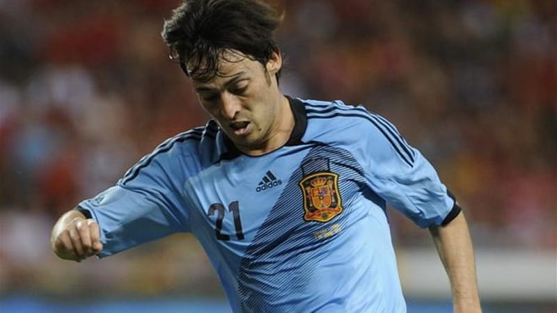 Playmaker David Silva has performed in both the blue of Manchester City and Spain in 2012 [AFP]