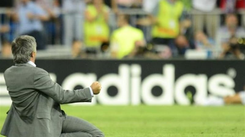 Real Madrid manager Jose Mourinho celebrates after his team battles back against Manchester City [AFP]