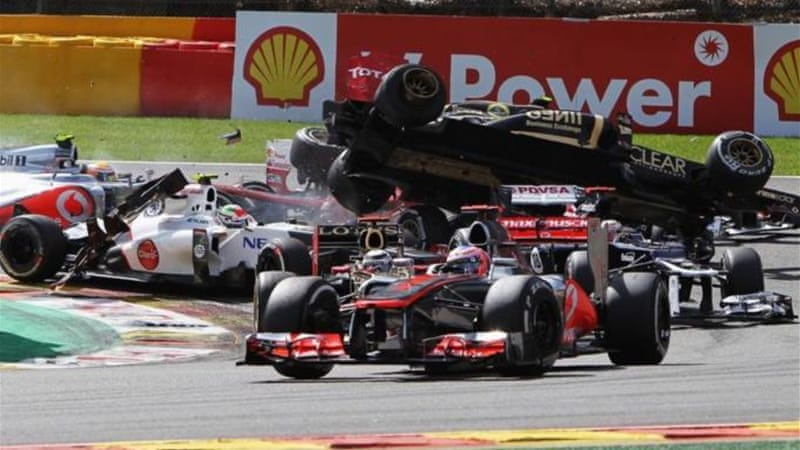 Romain Grosjean is catapulted into the air as he crashes during the first corner of Belgium Grand Prix [GETTY]
