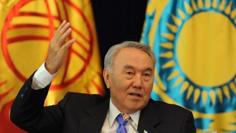 Karim Massimov and his replacement, Serik Akhmetov, are close allies of President Nursultan Nazarbayev [AFP]