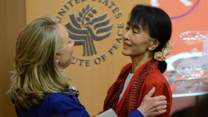 "Clinton said of Suu Kyi at the Institute of Peace that she was ""happy to see her here as a free and open citizen"" [EPA]"