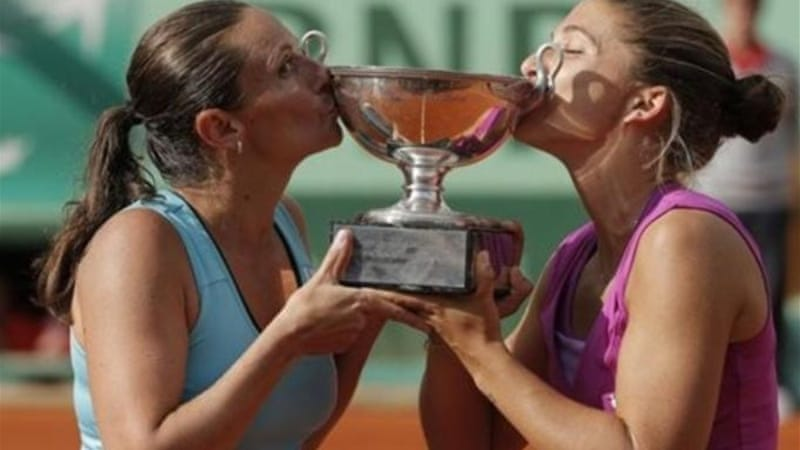 Good friends Errani (R) and Vinci won the women's doubles title together at the French Open in 2012 [AP]