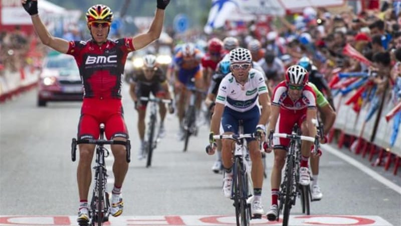 Belgium's Philippe Gilbert (L) of BMC Racing Team celebrates as he crosses finishing line to win stage 19 [AFP]