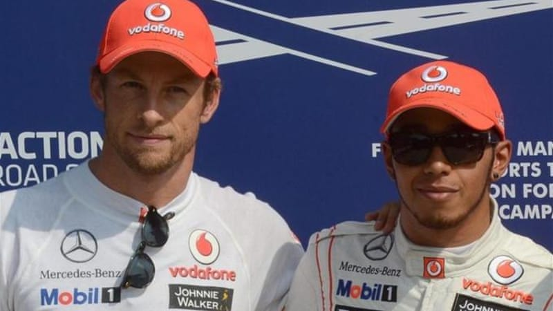 Team rivalry: Pole topper Lewis Hamilton (R) of McLaren alongside McLaren teammate Jenson Button [EPA]