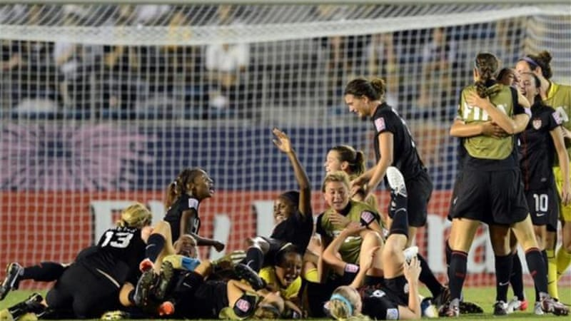 The Spain of women's football. The U.S. under-20 team celebrate their World Cup success [AFP]
