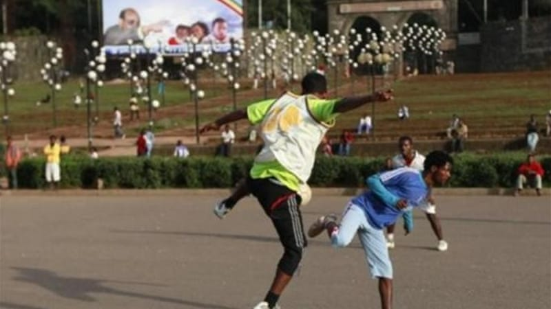 Poverty-stricken Ethiopia is ruled by leaders willing to reward sporting achievements in soccer-mad country [AP]