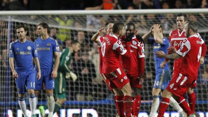 Former Chelsea player Shaun Wright-Phillips (C) respectfully chose not to celebrate his crucial goal [AFP]