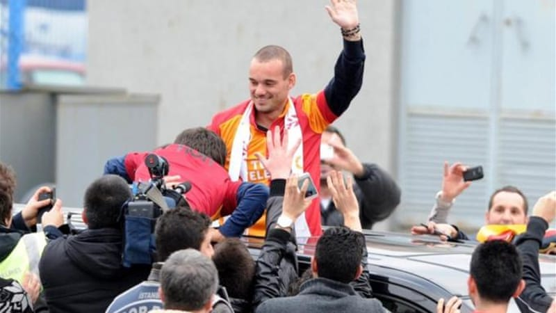 Sneijder is greeted by thousands of Galatarasay supporters after arrival in Istanbul on January 21 [AFP]