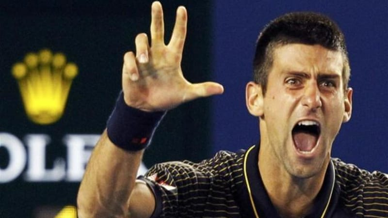 Three fingers for three titles in a row: Djokovic enjoys his moment with victory over Murray [Reuters]