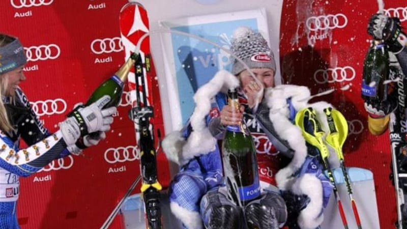 Mikaela Shiffrin of the U.S. is sprayed with champagne after her World Cup slalom victory [Reuters]