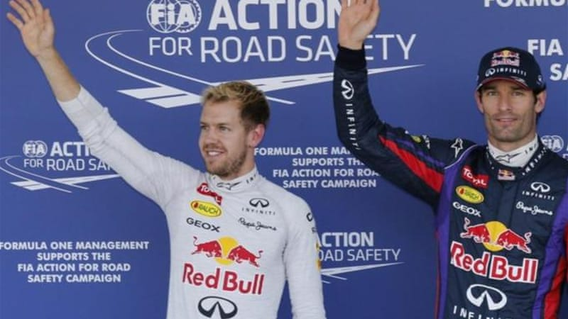 Webber (R) celebrates pole as Vettel (L) could be one win away from sealing his fourth world title [AP]