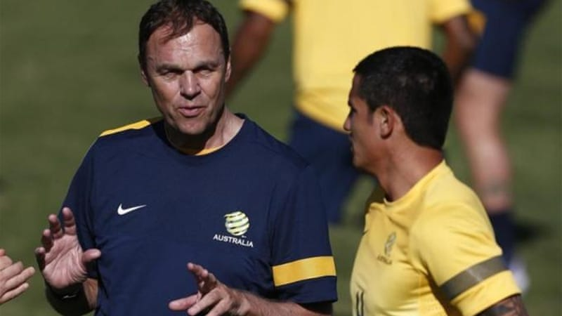 Tim Cahill (R) stood up for departing coach Holger Osieck (L) who had tough task of replacing ageing talent [Reuters]