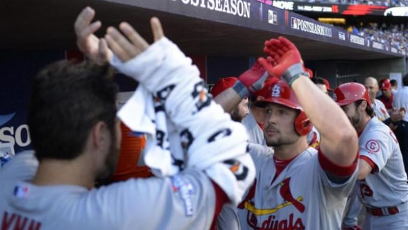 Cardinal Matt Holliday (C) celebrates with team after hitting a two-run home run against LA Dodgers [EPA]
