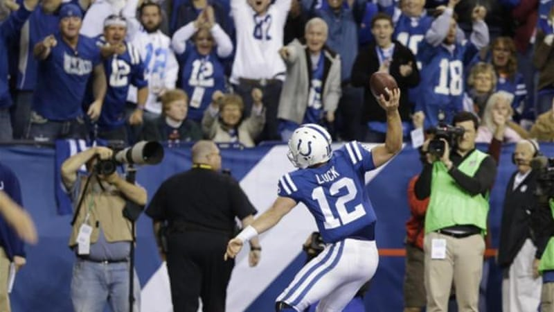 Luck celebrates running into the endzone for a touchdown in the win over Denver [AP]