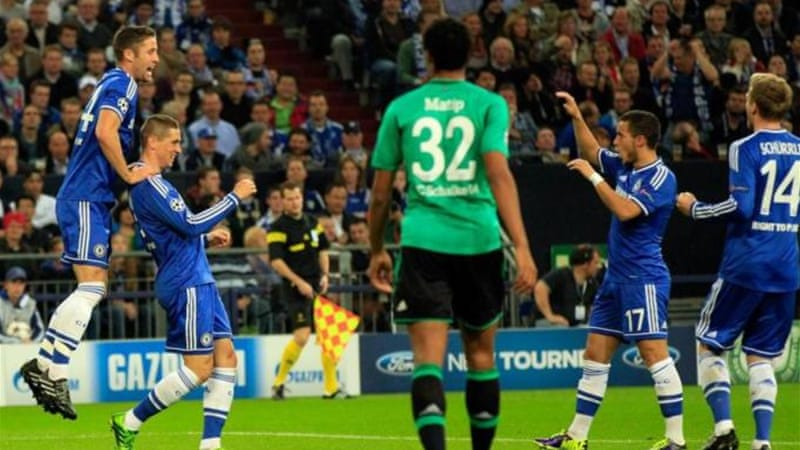 Torres (2nd left) celebrates after setting Chelsea on their way to a convincing victory over German rivals [AP]