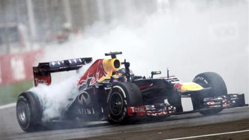 Vettel does some 'donuts' as he celebrates his dominance of Formula One [Reuters]
