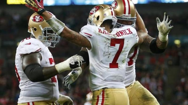 49ers quarterback Colin Kaepernick (C) celebrates second running touchdown with teammates at Wembley [Reuters]