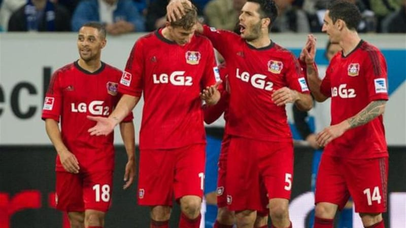 Leverkusen's Kiessling (2nd L) and teammates celebrate after ball shot through a hole in the netting [AP]