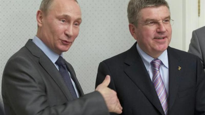 The head of Russia Vladimir Putin (L) and the head of the IOC Thomas Bach (R) meet in Sochi [Reuters]