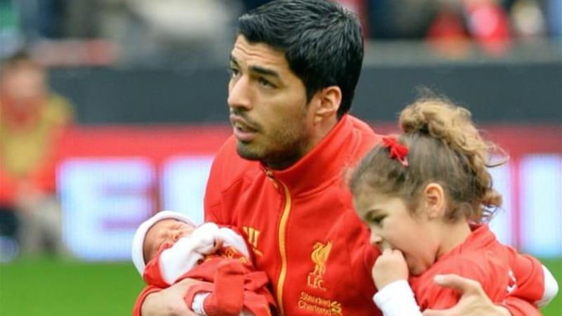 On his return to Anfield. Suarez showed off his family before showing off his football skills against Palace [AFP]