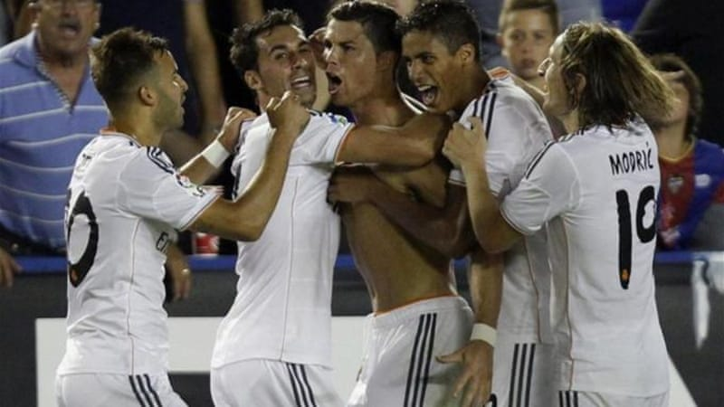 Ronaldo refused to be beaten once more with a crucial goal in injury time as Real grappled back [AP]