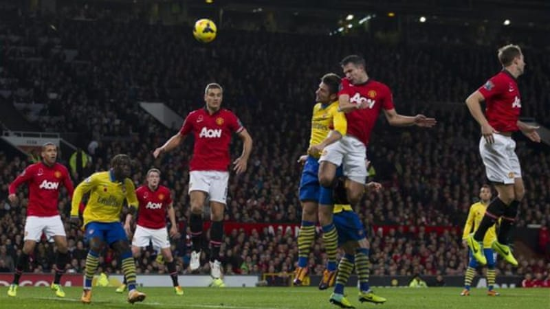 Van Persie rises above Olivier Giroud to score and move Man Utd above Man City who lost at Sunderland [AP]