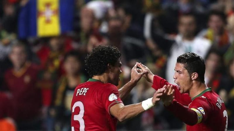 Ronaldo, right, celebrates his goal with Pepe but 1-0 is a slim advantage to take to Sweden [EPA]