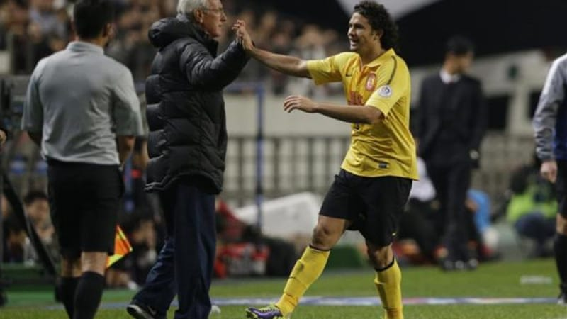 Marcello Lippi congratulates Elkeson after the Brazilian scored in the first leg of the final in Seoul [AP]
