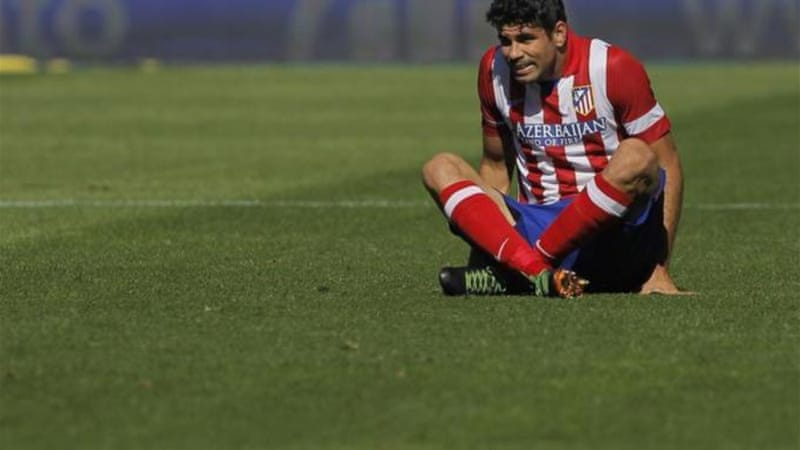 Sitting target: Costa may face recriminations when he plays on home soil for Spain at Brazil 2014 [AP]