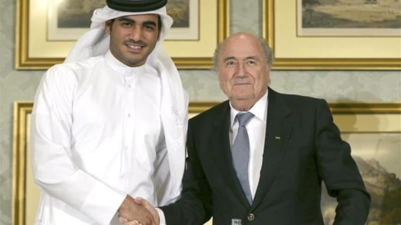 Sepp Blatter (R) shakes hands with Qatar's 2022 World Cup Bid Chief Sheikh Mohammed bin Hamad Al-Thani (L) [Reuters]